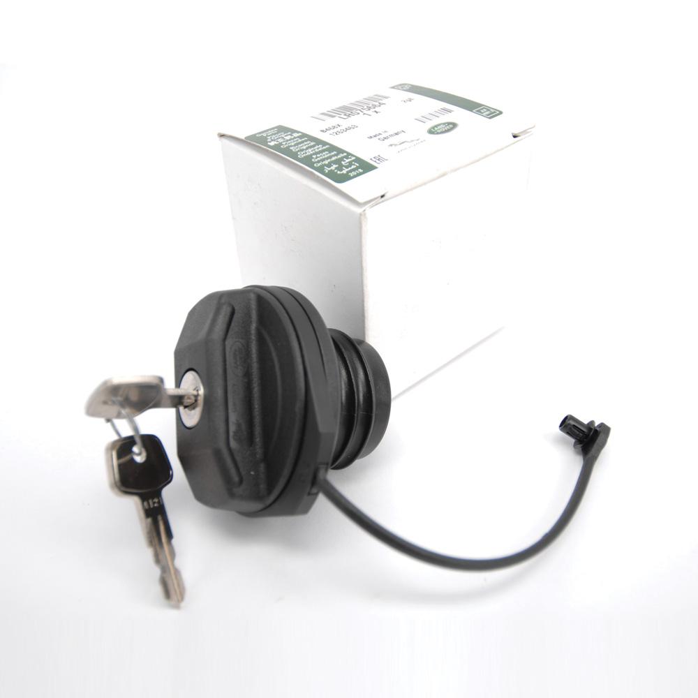 Genuine fuel cap with strap